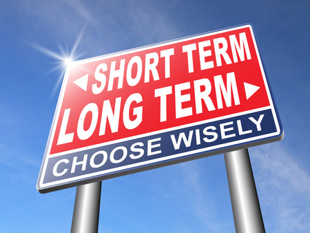 long term short term strategy planning or thinking plan and think ahead for the near and far future road sign arrow