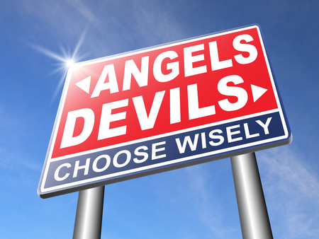 good and evil: devil and angel good or evil bad heaven and hell road sign with text arrow Stock Photo