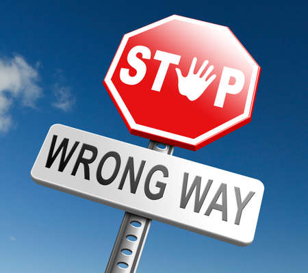 wrong way: wrong way stop and turn back now bad direction making mistakes Stock Photo