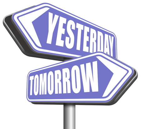 way of living: yesterday tomorrow live in the past or in the future time and date road sign Stock Photo