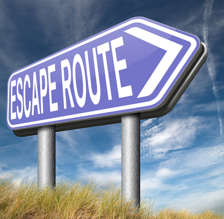 avoiding: escape route emergency exit avoiding stress and break free running away to safety no rat race road sign Stock Photo