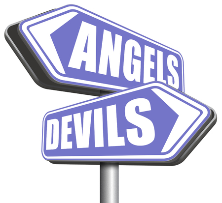 good and evil: devil and angel good or evil bad heaven and hell road sign arrow Stock Photo
