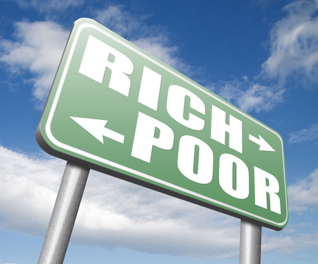 bad fortune: rich or poor take financial risk live in poverty or in wealth good or bad luck and fortune road sign arrow