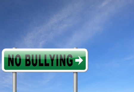 traumatic: Stop bullying at school or at work stopping an online internet bully Stock Photo