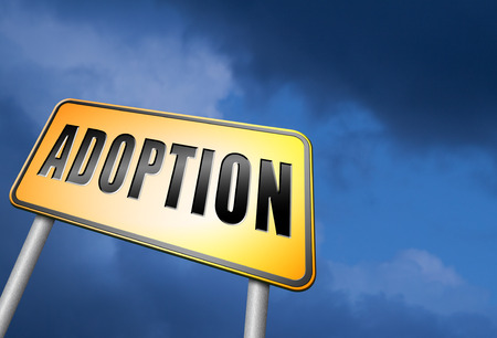 foster parenting: adoption road sign Stock Photo