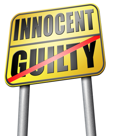 fair trial: innocent or guilty road sign Stock Photo