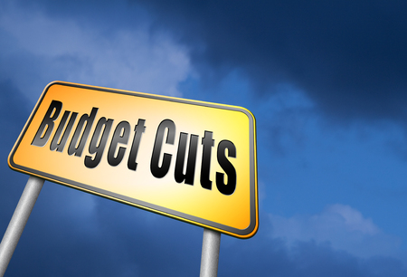 expenditure: Budget cuts road sign Stock Photo