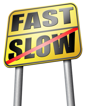 slow lane: fast or slow road sign