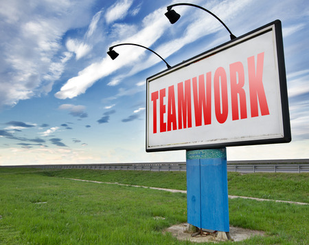 our company: teamwork button concept, team work and cooperation in partnership working together business partners