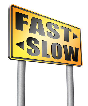 slow lane: fast or slow road sign billboard. Stock Photo