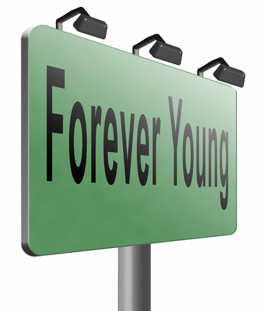 forever: Forever young road sign billboard. Stock Photo