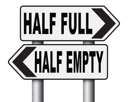 not full: half full or empty think positive not negative optimistic versus pessimistic look at the bright side not the dark Stock Photo