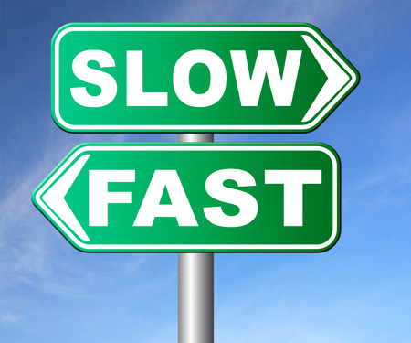 take it easy: fast or slow pace, lane or living faster or slower speed stop rat race and adapt to slower lifestyle take your time do it easy road sign arrow