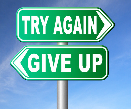 give up: try again give up keep going and trying self belief never stop believing in yourself road sign dont be a quitter persistence and determination Stock Photo