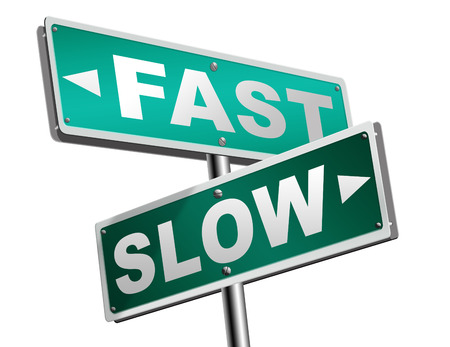 fast lane: fast or slow pace, lane or living faster or slower speed stop rat race and adapt to slower lifestyle take your time do it easy road sign arrow