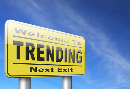 business trending: trending now in fashion business latest trends that are popular now, road sign billboard. Stock Photo