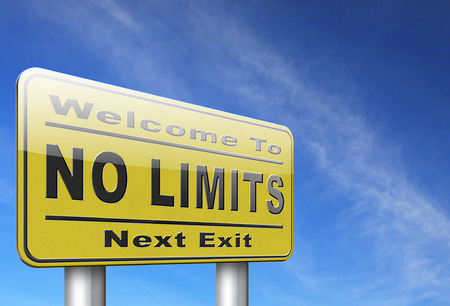 unlimited: no limits or boundaries go all the way unlimited and without restrictions road sign billboard