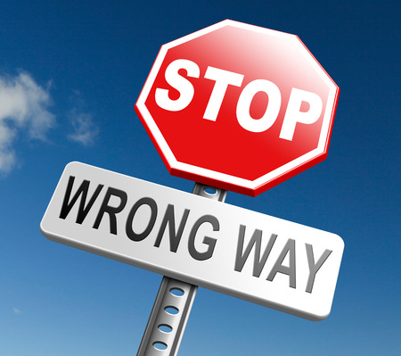 a way: wrong way stop and turn back now bad direction making mistakes Stock Photo