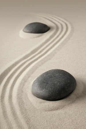 zen meditation, sand and stone background texture. Spa wellness or yoga theme for concentration relaxation and spirituality.