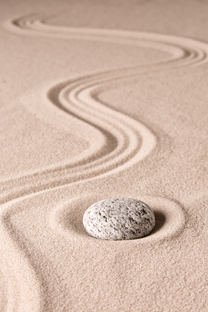 Japanese zen stone garden. Harmony and balance of rock and raked sand lead to concentration and meditation towards spirituality.
