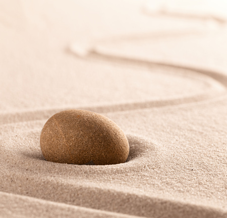 Yoga or zen Buddhism stone and sand background. Concentration or focus point for spiritual balance and purity of mind and soul. Sandy background with copy space. Standard-Bild - 119076652