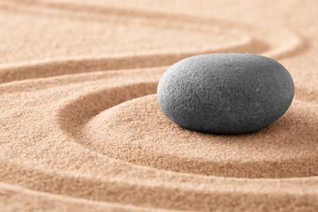 Japanese zen meditation stone and sand garden for mindfulness, relaxation, harmony balance and spirituality.