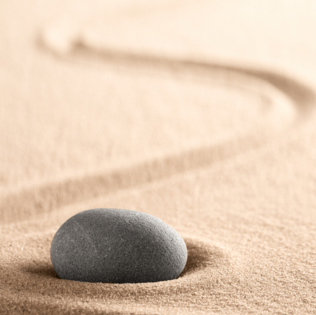 Zen meditation Japanese stone and sand garden with raked line. Concept for concentration and focus for purity, harmony and balance. Background with copy space. Standard-Bild - 119667809