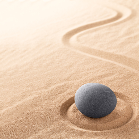 Spa wellness for inner life therapy and spiritual health. Zen meditation stone for relaxation. Concept for purity balance and harmony. Background with raked sand. Standard-Bild - 119667839