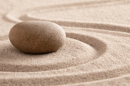 zen meditation stone and sand garden for mindfulness, relaxation, harmony balance and spirituality. Standard-Bild - 119667843