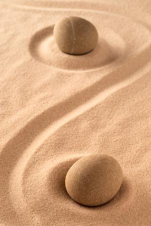 zen meditation stone in raked sand