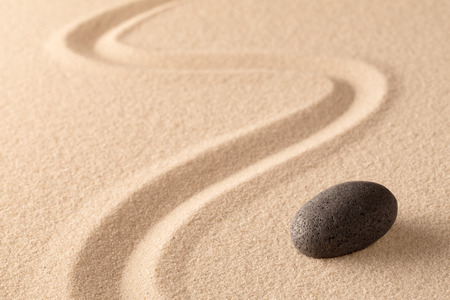 meditation stone in Japanese zen garden. Concept for focus and  concentration to reach spiritual balance, purity and harmony of mind and soul. Spa wellness or mindfulness background with copy space. Standard-Bild - 119667950