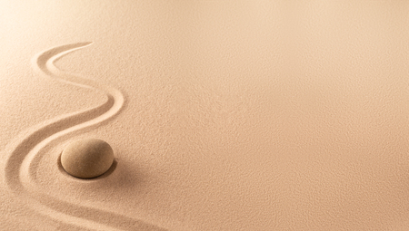 Spa wellness background of a zen meditation garden with sand and round stone. A nice curved line on sandy texture. Lots of copy space. Standard-Bild - 121959620