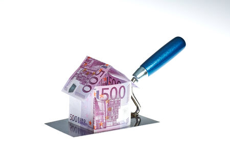 House from 500 Euro bills on trowel photo