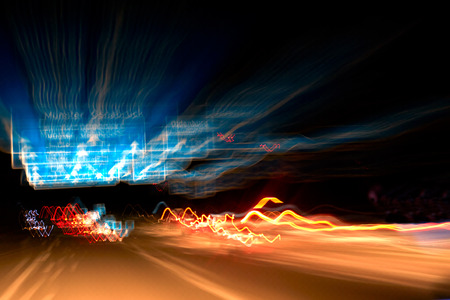 blurred taillights at night on the highway photo