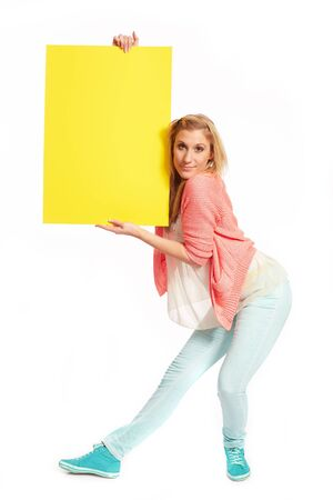 Young woman with funky yellow sign photo