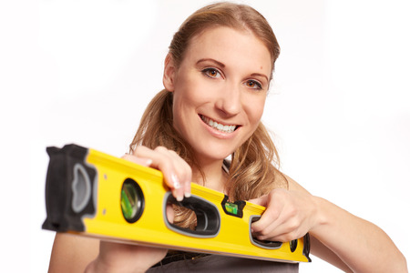 craftswoman: Young woman with a spirit level Stock Photo