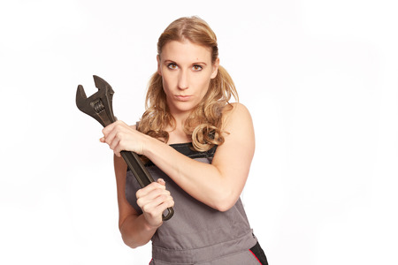 craftswoman: Young woman with a big wrench