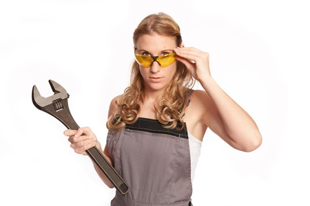 lend a hand: Young woman with a big wrench