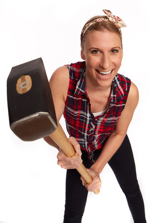 yourselfer: young woman with a big hammer