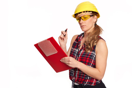 writing board: Young woman with hard hat and writing board Stock Photo