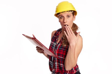 Young woman with hard hat and writing board photo