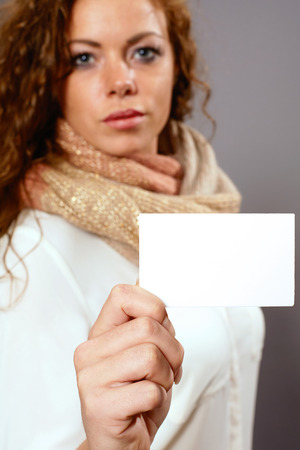 reklame: Woman with white advertising sign Stock Photo