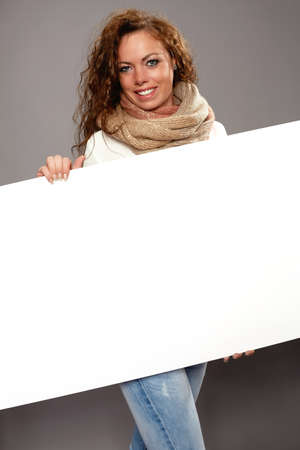 Woman with white advertising sign photo