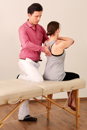 naturopaths: Orthopedic surgeon with a patient in treatment.