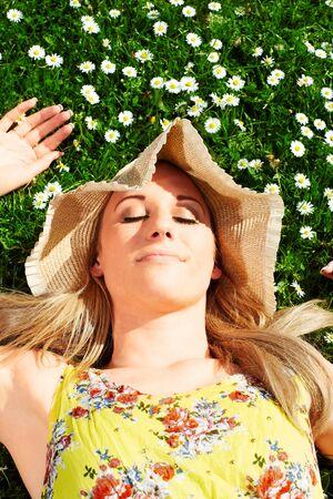 soulfulness: Blonde girl on a flower meadow..