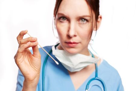 physican: Nurse in blue Op clothing with stethoscope and cotton buds as Cut Stock Photo