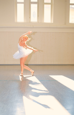 soulfulness: Young woman dancing in a ballet hall
