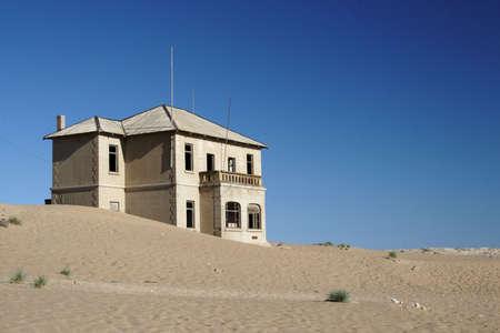 Old ruin in the abandoned diamond town Kolmanskop in Namibia photo