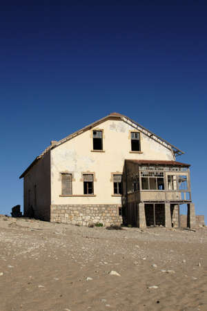 Old ruin in the deserted diamond town Kolmanskop in Namibia Stock Photo - 4783804