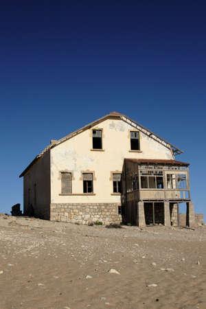 Old ruin in the deserted diamond town Kolmanskop in Namibia Stock Photo - 4783804